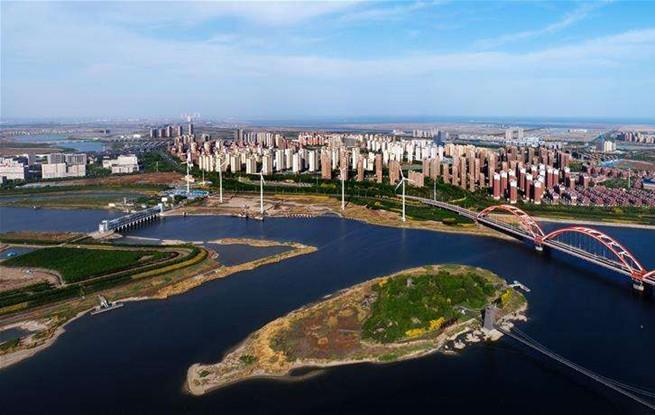 中新天津生态城探索引领生态文明示范
