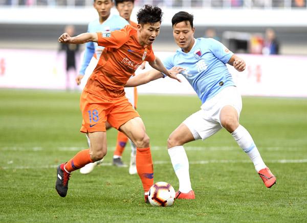 中超联赛:山东鲁能队战胜天津天海队
